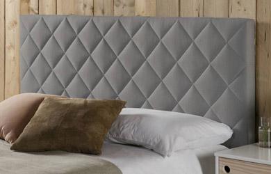 Cabezal tapizado de color gris 140x60